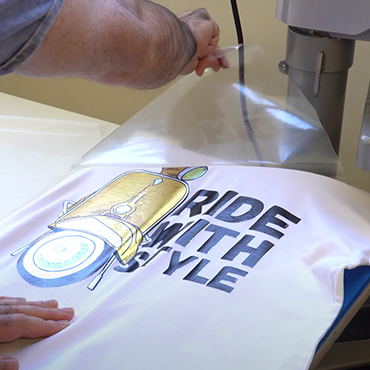 Aplicación transportadora en vinilo textil