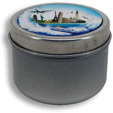 Caja de metal redonda con placa y vela aromática