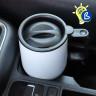 Taza termo inoxidable blanca - En el posavasos de un coche